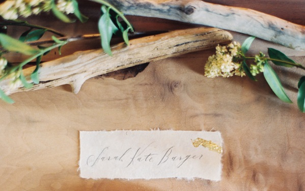 DIY Gold Leaf Place Cards | The layering of handmade paper with natural edges, charcoal writing, and organic gold leafing make these name cards a detailed gem to a simple tablescape.