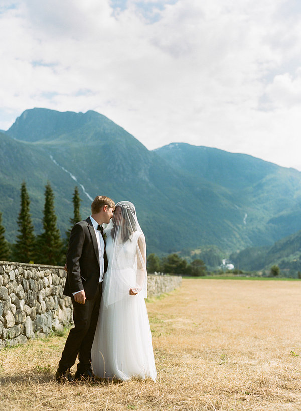 NORWAY: Intimate Fjords Wedding | A celebration in Rosendal, a small town overflowing with natural beauty and a rich cultural heritage, includes scenes of a medieval stone church that was built in the 1200s.