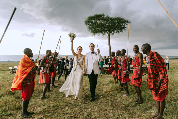 AFRICA: Colorful Destination Wedding | This stunning Kenyan wedding was full of unique African details such as a traditional Maasai necklace and bracelets worn by the bride, arrival to the ceremony in safari land rovers, Maasai shukas for all guests, and old African bed time stories and bouquets of locally grown roses placed in guest's rooms in the evening.
