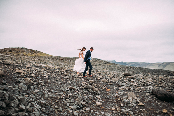 "ICELAND: Romantic Elopement | After their wedding flew by too quickly, this French couple renewed their vows (""eloped"") on the beach in Iceland, where the crashing waves played center stage."