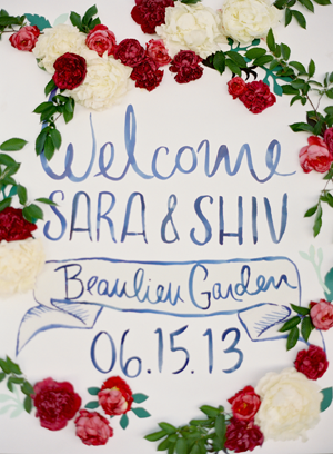 Colorful Red Floral Welcome Sign