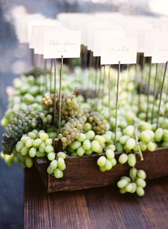 We love the effect of this lush escort card table. Use Rustic Wooden Boxes filled with your choice of seasonal fruits along with beautifully calligraphed name cards to recreate this sweet look. It would be an absolutely perfect addition to a summer vineyard wedding.