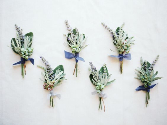 Using fruit in personal flowers is a detail we simply adore. Here we have blueberries tied together with delicate lavender and sage to create sweet and organic boutonnieres for the groom and his men. We love the foraged feel of the foliage mixed with the elegant look of the silk ribbon . We imagine blueberries and lavender in the bridesmaid bouquets to accompany this look.