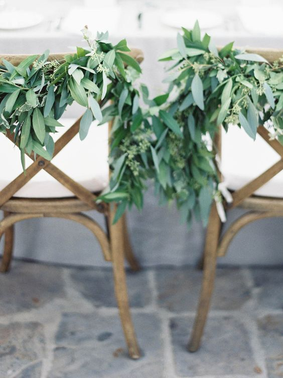 Adding a small garland to the newlywed's chairs is a sweet way to continue infusing green details into your wedding décor. We love that it doesn't take too much extra time or resources to turn something into a special wedding detail.