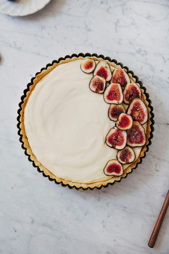 Perfect for an autumn affair, a fresh fig and lemon cream tart would be a beautiful and delicious substitute to a wedding cake. We can imagine this pretty tart sitting on a  wooden cake stand  or  wooden cutting board  surrounded by autumn fruit and pretty candlelight.