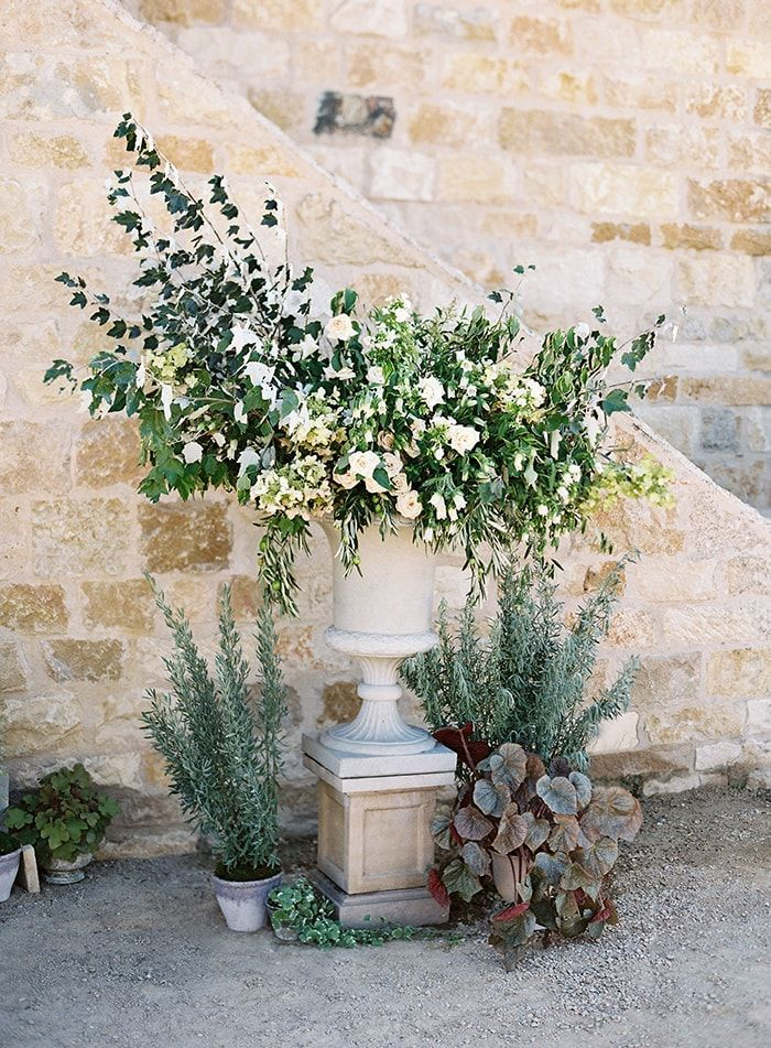 28-green-floral-arrangement-stone-urn