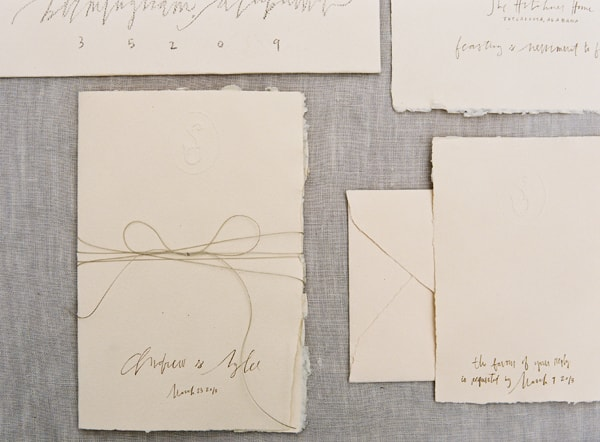 6-meagan-tidwell-callicraphy-ivory-handmade-paper-invitation-suite-bow-twine-blind-embossed