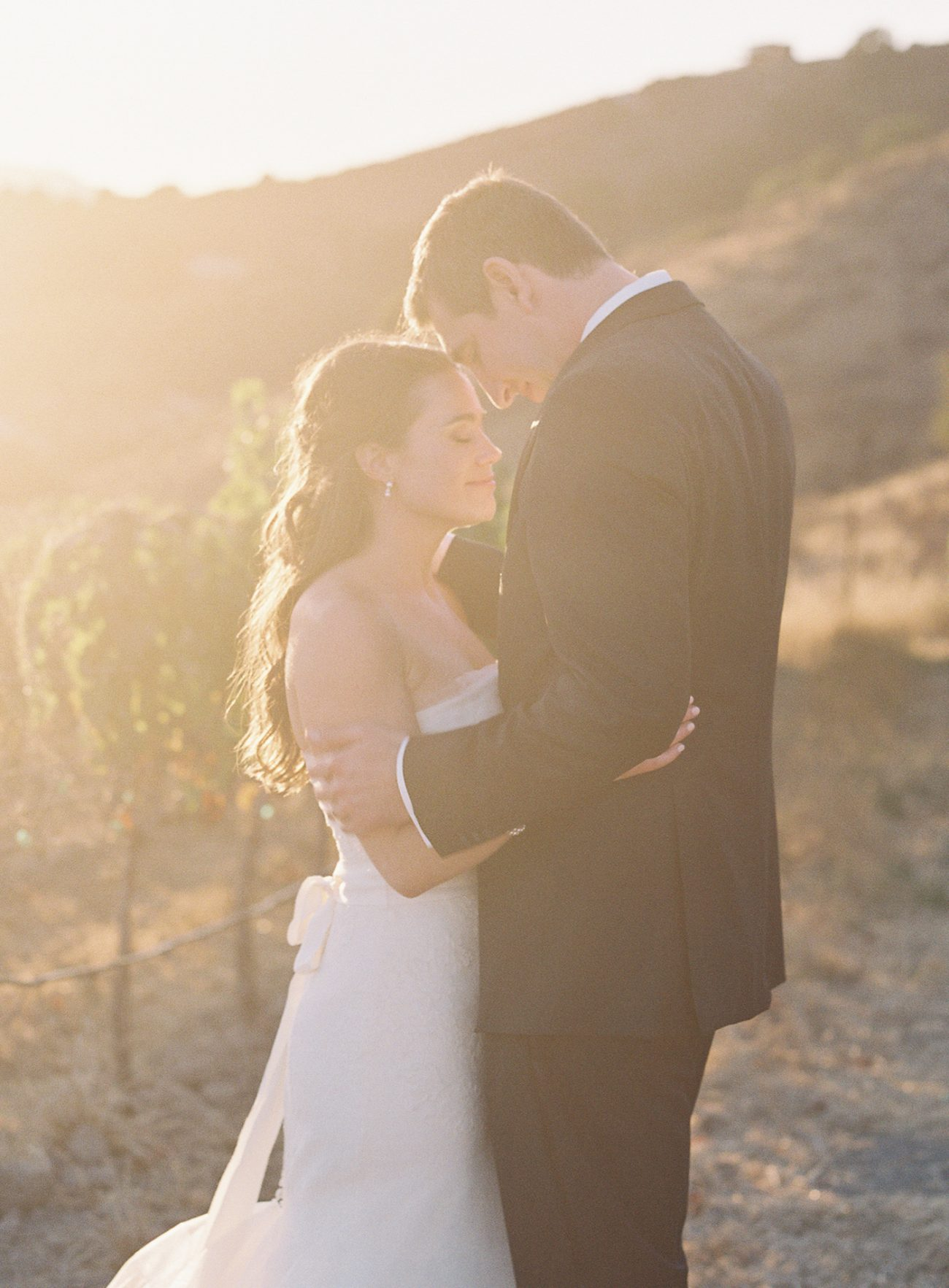 Family and Friends Gather at California Basilica for Outdoor Vineyard Wedding Featuring Rustic and Blush Accents