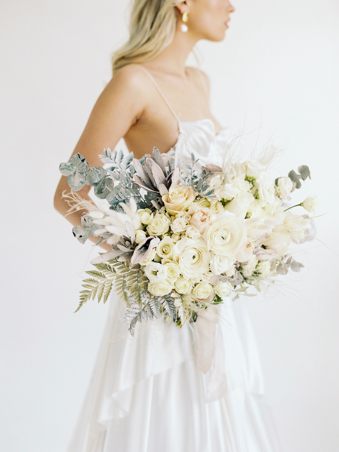 Natural, Minimalistic Bridal Editorial featuring Modern, Ocean Themes and Pops of Gold