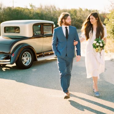 Antique Cadillac Adds Classic Style to Unique Engagement Shoot Featuring Red, Green, and Neutral Tones