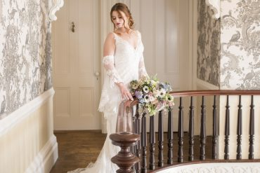 bride posing on wood staircase