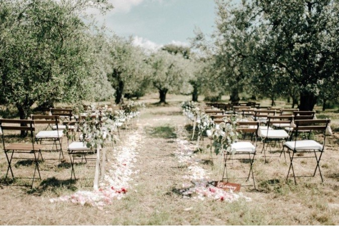Neutral and organic rustic farm wedding in Tuscany.