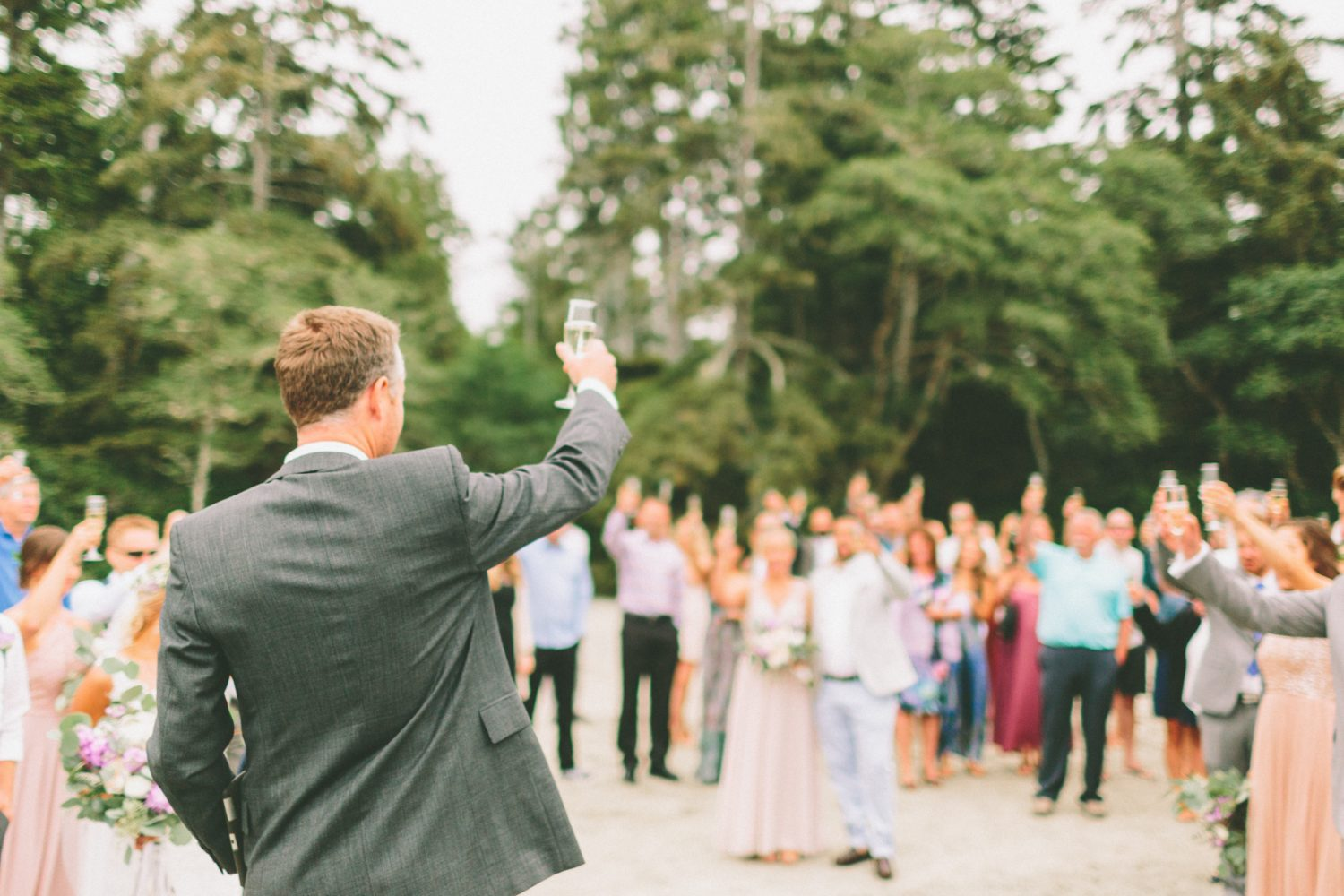 Man giving a toast to wedding guests